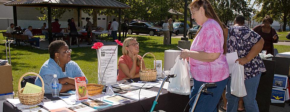 Adams Park Apartments residents visit informational tables at on-site health fair